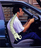 Man in car seat with very poor posture