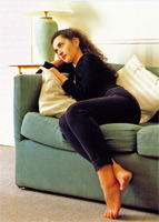 Woman leaning heavily on a sofa